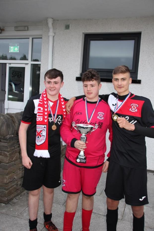 Clydebank Post: Man of the match, Fraser Buchanan, centre, was the penalty shootout hero