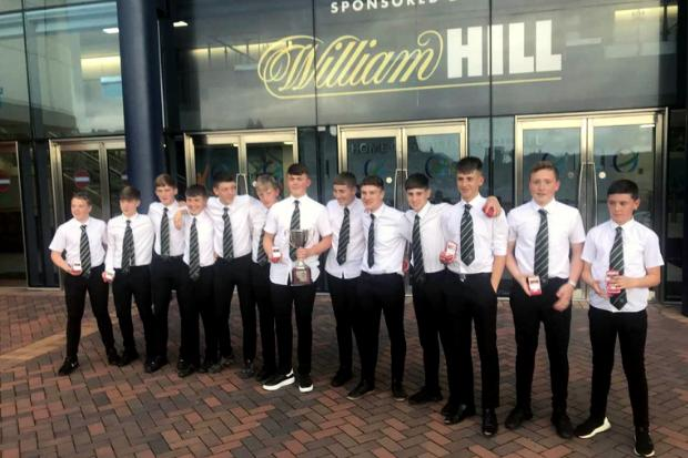 The Drum youngsters collect their GADYFL league and cup trophies at the national stadium