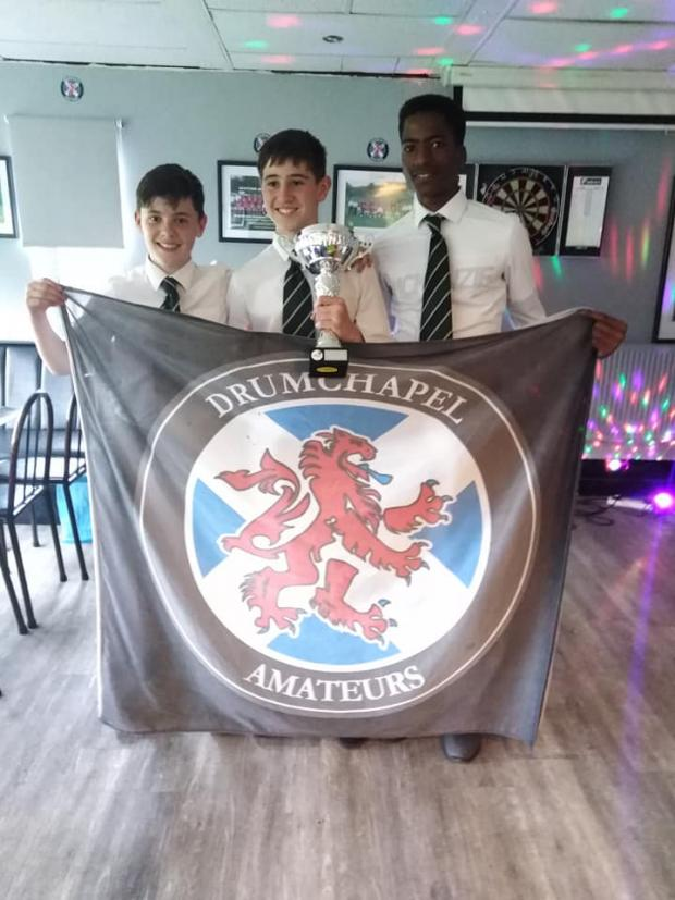 Clydebank Post: Lorcán Deeley, Patrick Shiels and Abraham Osemeke with the U15s league cup