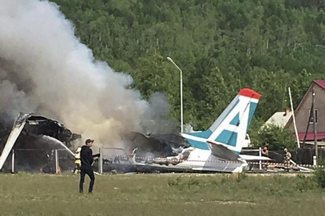 A plane burns after it crashed during landing in Nizhneangarsk, Republic of Buryatia, south-east Russia