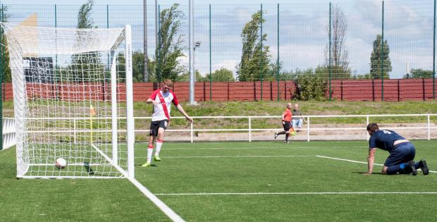 Clydebank Post: Bankies trialist Aaron Miller taps home the first goal at the refurbished Holm Park (Photo: Stevie Doogan)