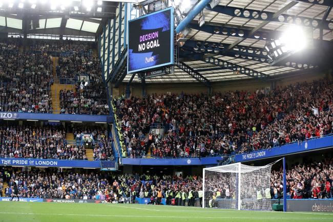 The big screen shows that Chelsea's Cesar Azpilicueta's goal is disallowed against Liverpool