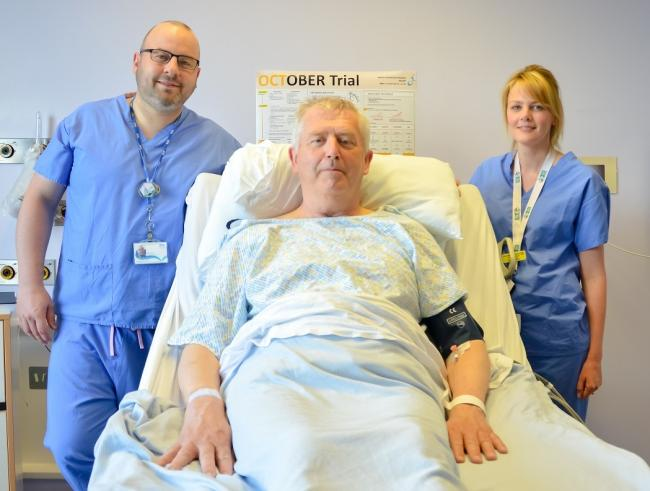 Consultant Cardiologist Stuart Watkins and Cardiology Research Nurse Louise Graham with the first patient David Newman