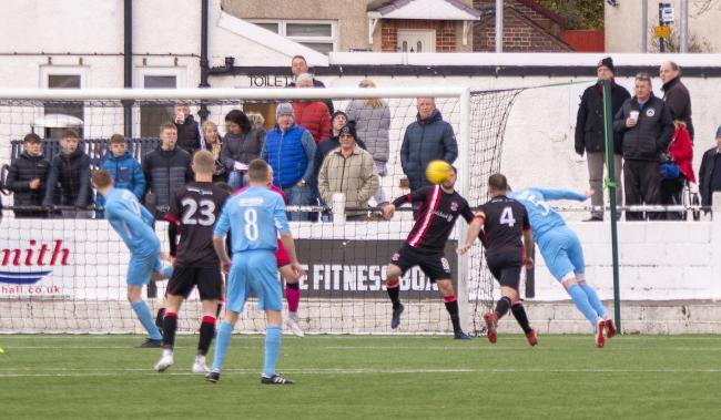 Andy Dowie gets in front of Alan Vezza to head Cumnock in front                        Photo: Stevie Doogan