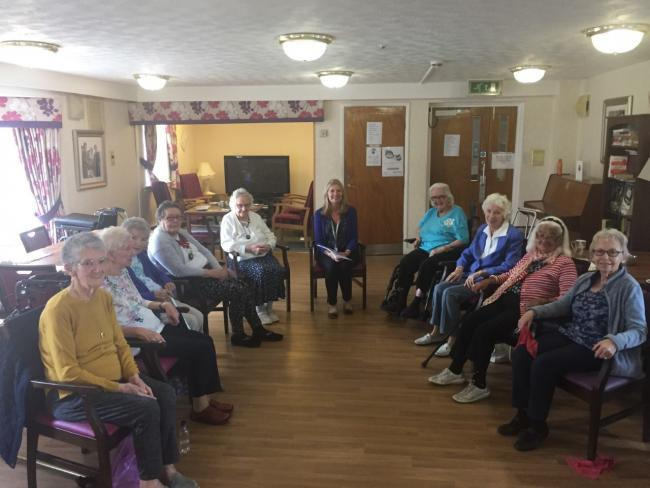 Charlotte and Elizabeth lead chair-based exercise classes for pensioners