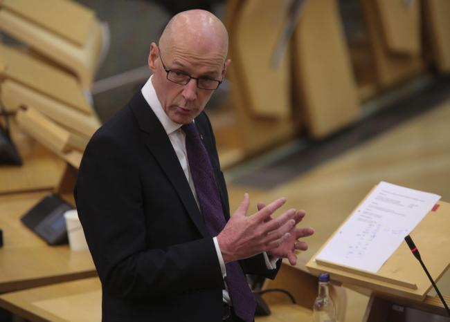 Deputy First Minister and Education Secretary John Swinney during Topical Questions at the Scottish Parliament, Edinburgh. Swinney said pupils should prepare to return to school on a full-time basis in August. PA Photo. Picture date: Tuesday June 23, 2020