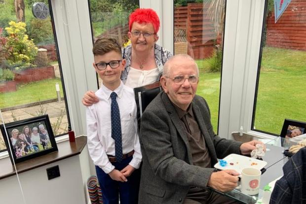 Clydebank Post: Mary Barr, with red hair, her husband Neilly and great-grandson Jayden