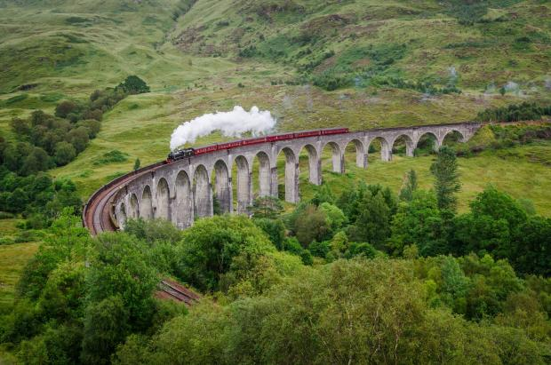Clydebank Post: View of a steam train on a famous Glenfinnan viaduct, Scotland; Shutterstock ID 154641122; PO: THE HERALD MAGAZINE ; Job: TRAVEL