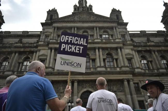 Janitors on strike outside Glasgow City Council Chambers on June 9