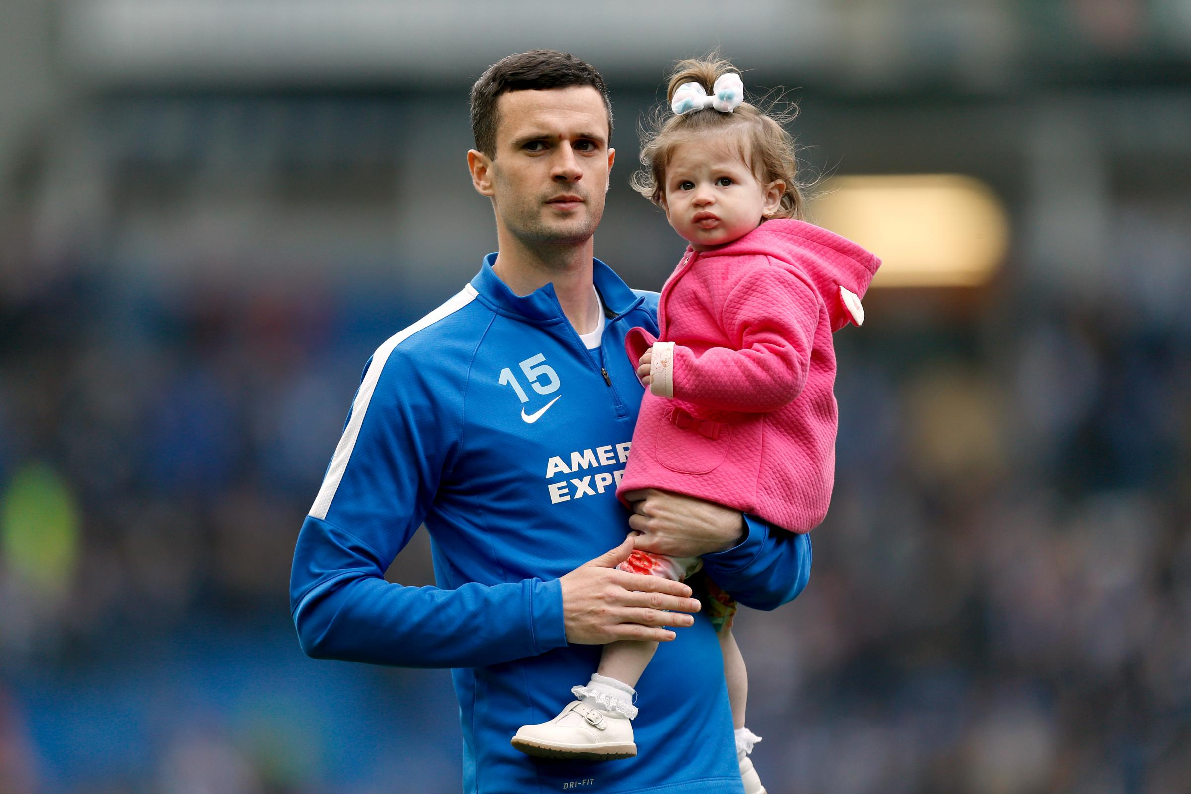 Jamie Murphy with one of his daughters before a Brighton game
