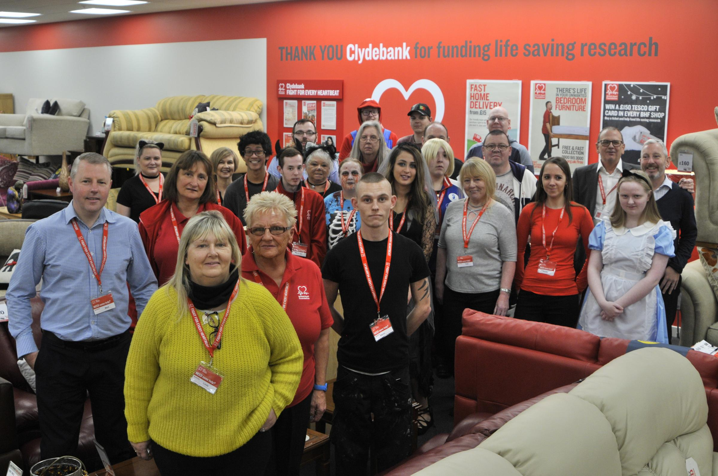 Staff and volunteers of the new BHF store in Clydebank get ready to welcome customers