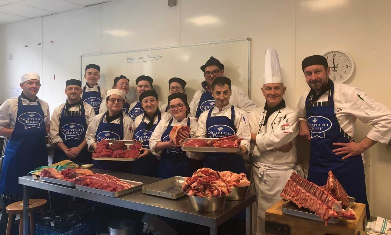 Students pictured at the butchery course with Mr Ovens