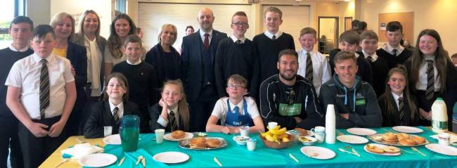 Clydebank High breakfast club with Laura Mason, chief education officer, Councillor Ian Dickson, and Patrick Kelly and Kieran McDonald from Glasgow Warriors